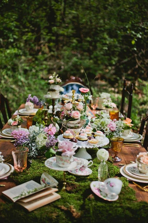 Whimsical-Alice-In-Wonderland-Moss-Wedding-Centerpiece-min